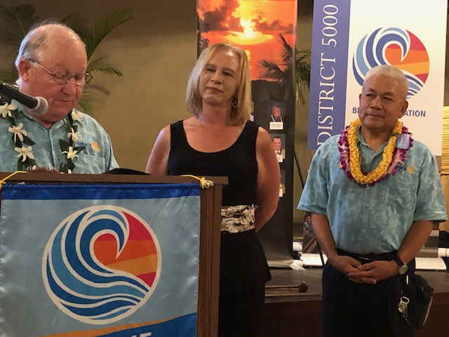The swearing in of Michele Ku as the 2019-2020 President of Kona Sunrise Rotary by Governor Win. 2018-2019 President Nestorio Domingo stands beside Michele.